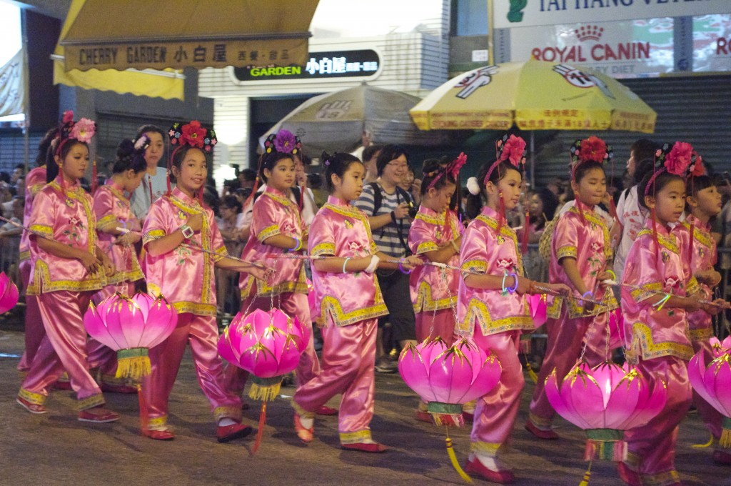 Girls in traditional costumes and lanterns