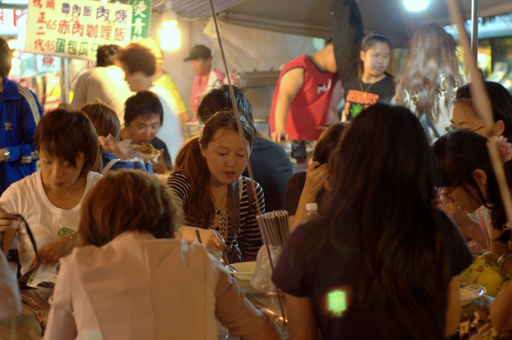 Bustling night market activity at Ningxia Night Market in Taipei