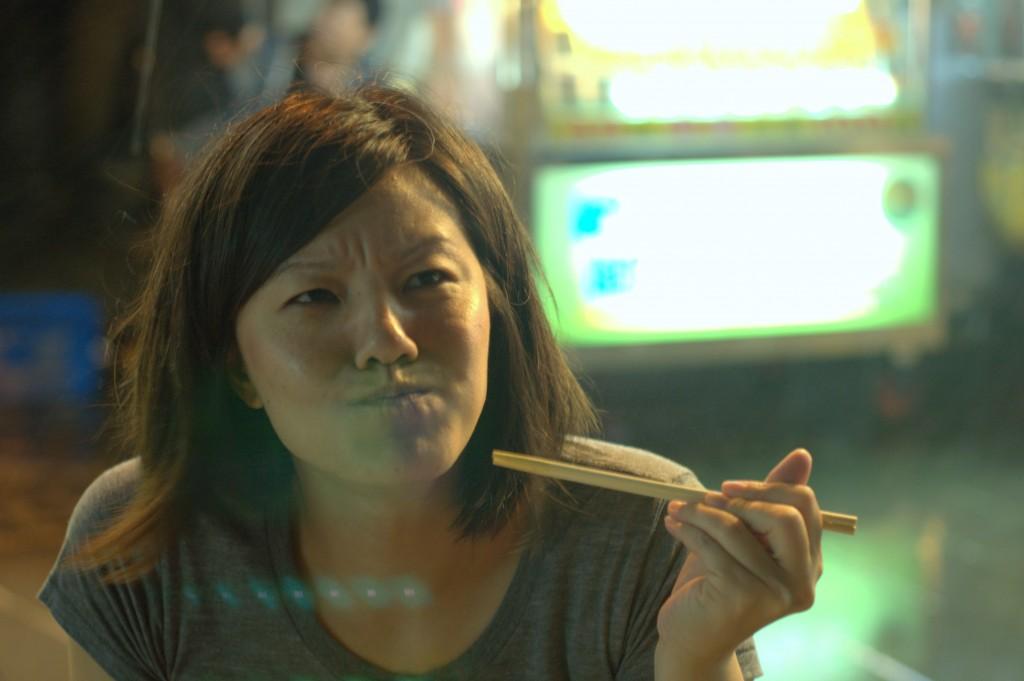 Daringly trying stinky tofu in a night market in Taipei