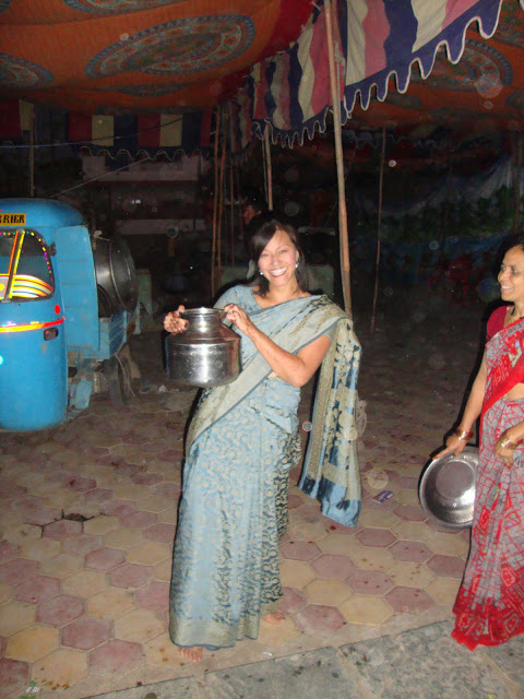 "Collecting water in India during my ""All's Well That Ends Well"" fundraiser."