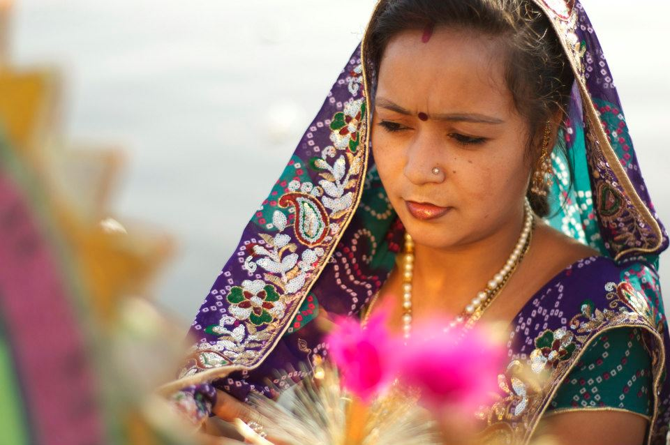 A woman offering a blessing at the Mewar Festival.