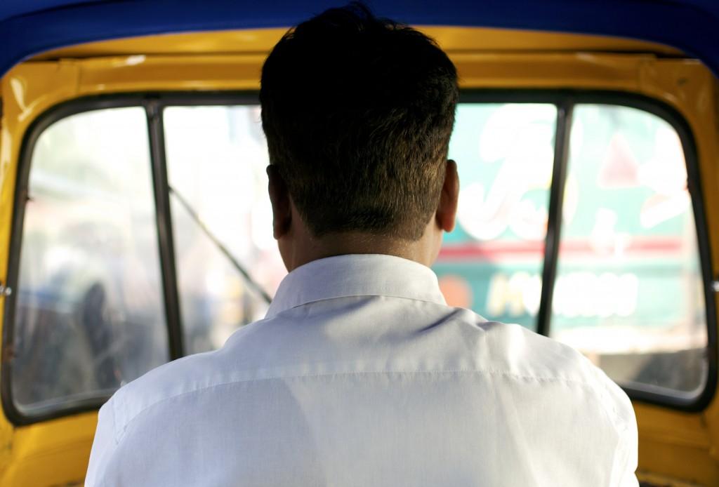 Rickshaw driver in India.
